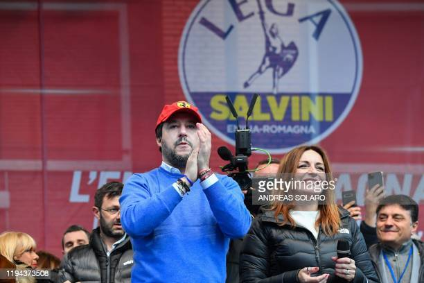 Leader of Italy's far-right League party, Matteo Salvini and centre-right Senator and regional candidate Lucia Borgonzoni react on stage during a...