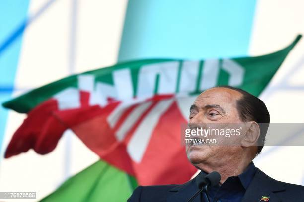 Leader of Italy's liberal-conservative party Forza Italia, Silvio Berlusconi speaks during a rally of Italy's far-right League party, conservative...