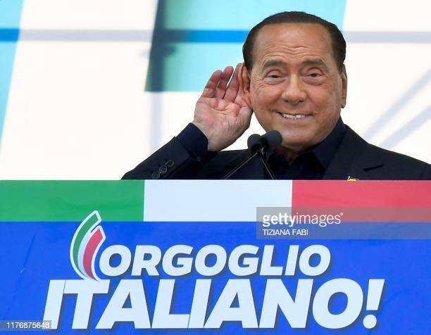 Leader of Italy's liberal-conservative party Forza Italia, Silvio Berlusconi gestures as he speaks during a rally of Italy's far-right League party,...