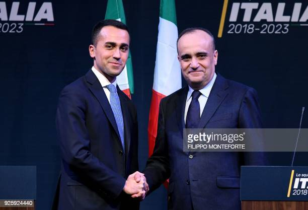 Leader of Italy's populist Five Star Movement Luigi Di Maio shakes hands with Alberto Bonisoli who would become his Cultural Heritage Minister if he...