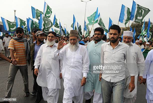Leader of JamaateIslami Pakistan Syed Munawar Hassan waves to supporters during an antiUS and NATO rally in Karachi on July 15 2012 Islamabad agreed...