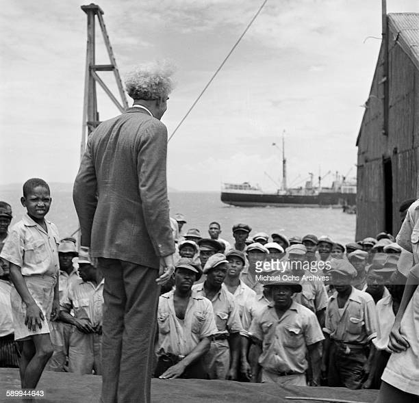 Leader of Jamaica Labour Party Sir Alexander Bustamante talks with local dock workers as he runs for Mayor of Kingston in Kingston Jamaica