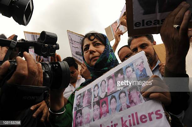 Leader of Kashmir's main opposition party Peoples Democratic Party Mehbooba Mufti, holds a placard showing photos of civilians killed during protests...