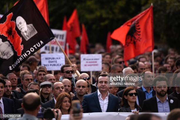 Leader of Kosovo's opposition party Vetevendosje Albin Kurti takes part in a march with his supporters as they take part in an antigovernment protest...