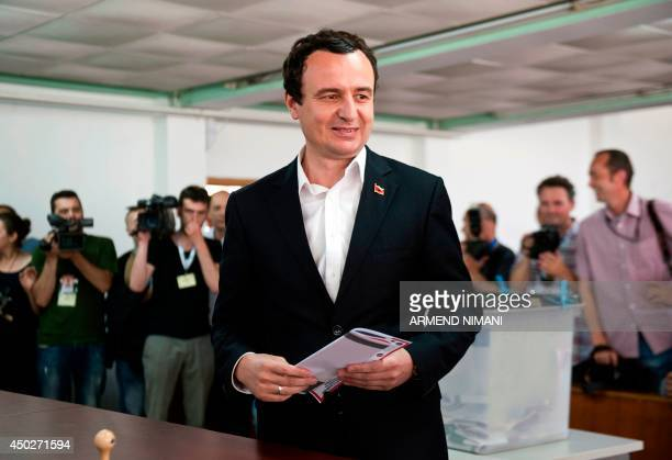 Leader of Kosovo's opposition party 'Vetvendosje' Albin Kurti prepares to cast his ballot at a polling station in Pristina on June 8 during Kosovo's...