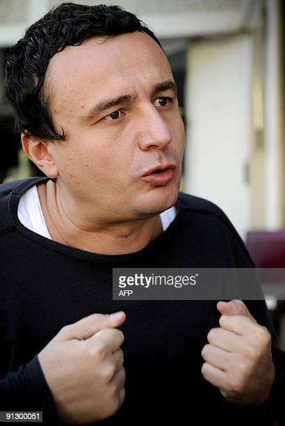Leader of Kosovo�s Selfdetermination movement Albin Kurti talks to an AFP correspondent during an interview in Pristina on September 24 2009 Kurti...