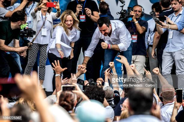 Leader of Lega Matteo Salvini and leader of Fratelli d'Italia Giorgia Meloni greet supporters at the end of a demonstration organized by Lega...