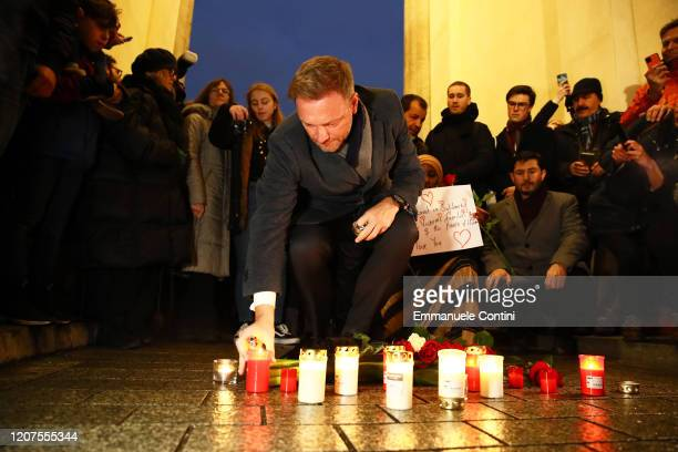 Leader of Liberal Party Christian Lindner lays a candle for a vigil at the Brandenburg Gate to commemorate the victims of the Hanau shootings on...