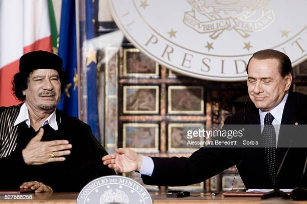 Leader of Libia Muammar Al Gaddafi during a joint press conference with Italy's Prime Minister Silvio Berlusconi at Villa MadamaGaddafi is making his...