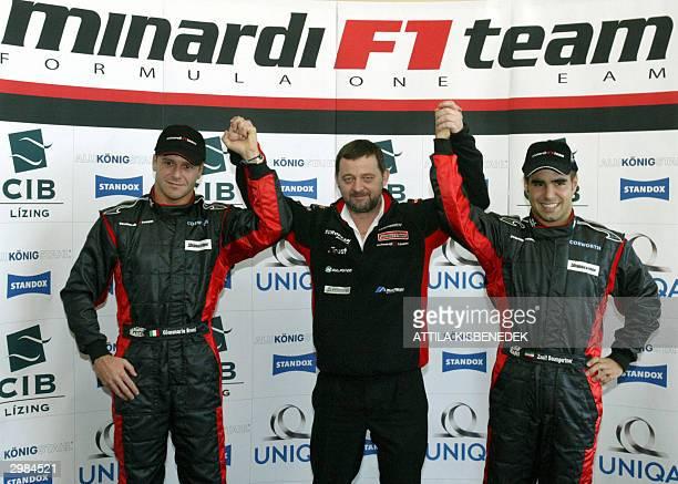 Leader of Minardi Formula One team Paul Stoddart raises hands with teammates Italian Gianmaria Bruni and Hungarian Zsolt Baumgartner in Budapest 15...