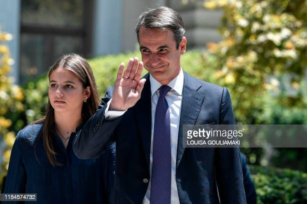 Leader of New Democracy conservative party and winner of Greek general election Kyriakos Mitsotakis greets while leaving the presidental palace with...