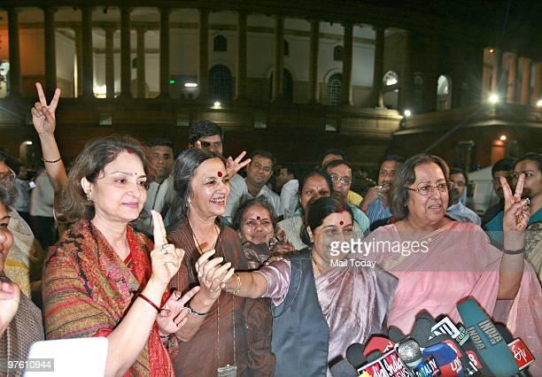 Leader of Opposition in Lok Sabha Sushma Swaraj BJP leader Najma Heptullah and CPI leader Brinda Karat celebrate the passing of Women's Reservation...