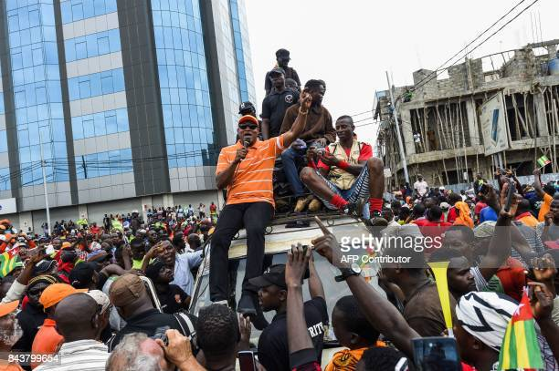 Leader of opposition JeanPierre Fabre sits on a truck to address supporters during an antigovernment protest led by a coalition of opposition parties...