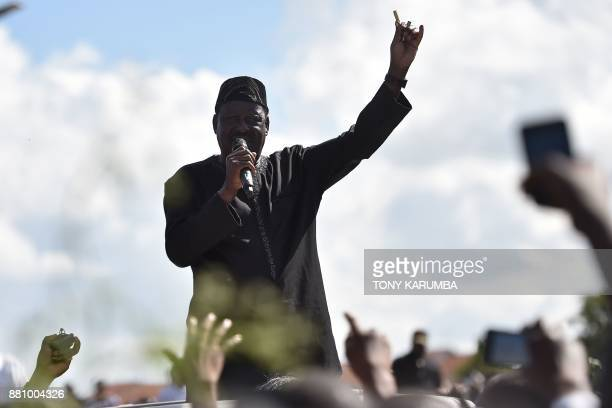 Leader of opposition Raila Odinga addresses his supporters on November 28 2017 during demonstrations at Umoja subururb of capital Nairobi after...