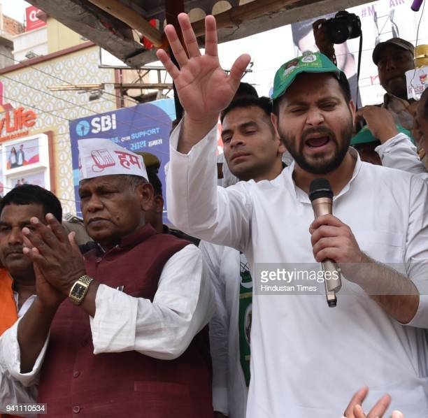 Leader of Opposition RJD Tejashwi Prasad Yadav RJD leader Tej Pratap Yadav and Hindustani Awam Morchaaa party president Jitanram Manjhi addresses a...