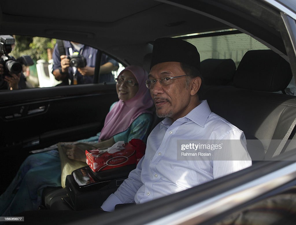 Leader of Pakatan Rakyat, Anwar Ibrahim gesture to a group of journalists as he exits the voting station on May 5, 2013 in Penanti, Penang, Malaysia. Millions of Malaysians cast their vote on Sunday in one of the most tightly contested Malaysian election since independence in 1957. The opposition coalition, Pakatan Rakyat (People's Alliance), led by former deputy prime minister Anwar Ibrahim is seeking to gain power on a national level against the ruling party Barisan Nasional.
