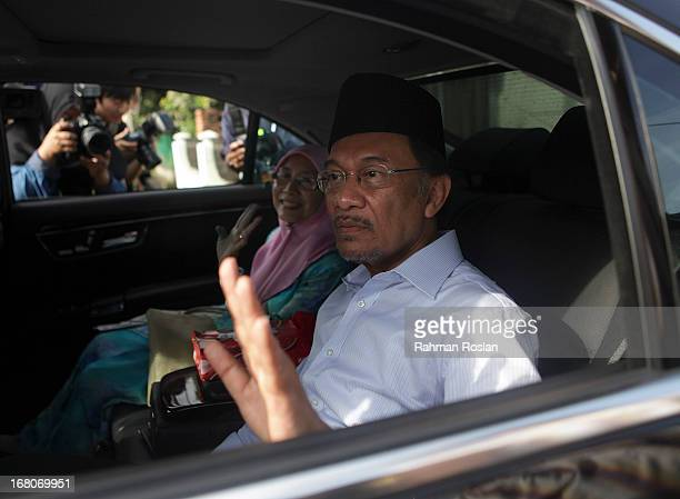 Leader of Pakatan Rakyat Anwar Ibrahim greet his supporters after casting his vote on May 5 2013 in Penanti Penang Malaysia Millions of Malaysians...