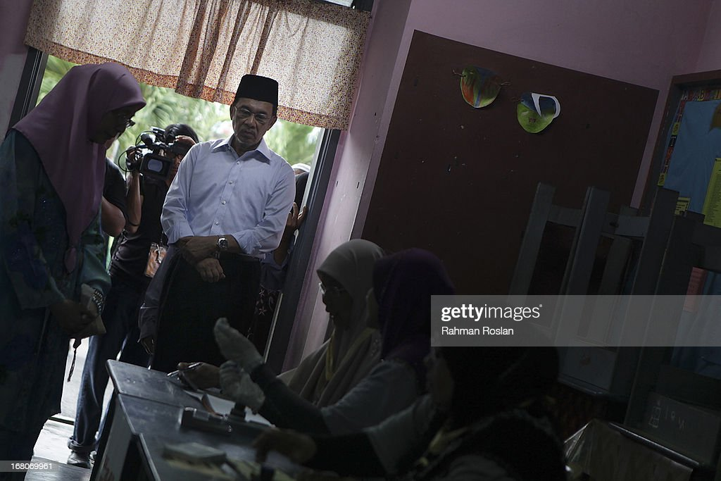 Leader of Pakatan Rakyat, Anwar Ibrahim waits for his turn to casts his vote on May 5, 2013 in Penanti, Penang, Malaysia. Millions of Malaysians cast their vote on Sunday in one of the most tightly contested Malaysian election since independence in 1957. The opposition coalition, Pakatan Rakyat (People's Alliance), led by former deputy prime minister Anwar Ibrahim is seeking to gain power on a national level against the ruling party Barisan Nasional.