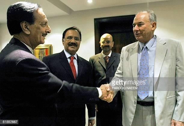 Leader of Pakistani Opposition party the Pakistan Muslim League N Raja Zafar ul Haq shakes hands with Commonwealth Secretary General Don McKinnon as...