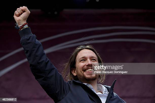 Leader of Podemos Pablo Iglesias raises his fist on stage at the end of a march on January 31 2015 in Madrid Spain According to the last opinion...