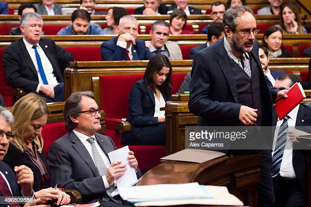 Leader of Popular Unity Candidacy 'Candidatura d'Unio Popular' Antonio Banos passes by acting President of Catalonia Artur Mas during the...