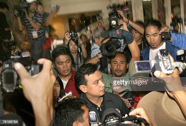 Leader of rebel soldiers Senator Antonio Trillanes is mobbed by journalists after taking over the luxury hotel in the financial district of Makati...