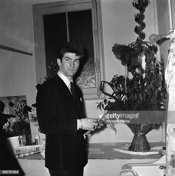 Leader of rock group 'Les Chaussettes Noires' Eddy Mitchell in his dressing room at the Olympia music hall before the concert on May 8, 1963 in...