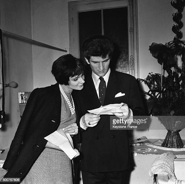 Leader of rock group 'Les Chaussettes Noires' Eddy Mitchell with wife Françoise in his dressing room of the Olympia music hall reading fans letters...