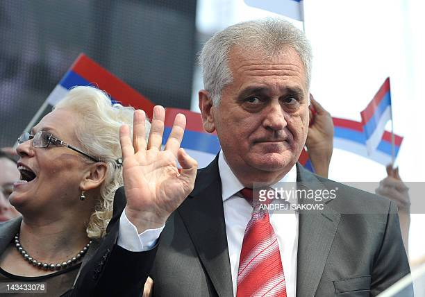 Leader of Serbian Progressive Party Tomislav Nikolic waves to his supporters during a rally in Belgrade on April 26, 2012. More than 10,000...