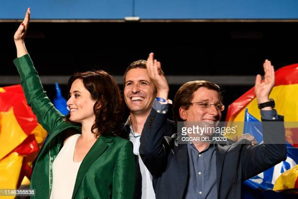 Leader of Spanish People's Party conservative Pablo Casado celebrates the election results with PP candidate to Madrid's regional government Isabel...