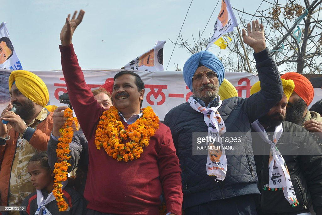 Leader of the Aam Aadmi Party and Chief minister of Delhi Arvind Kejriwal and AAP candidate for Amritsar Lok Sabha bypoll Upkar Singh Sandhu wave to..