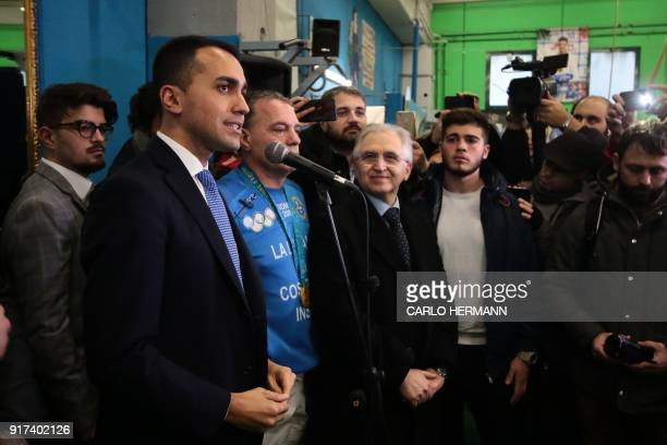 Leader of the anti-establishment Five Star Movement Luigi Di Maio speaks flanked by Italian Judo Olympic champion Gianni Maddaloni during a rally at...