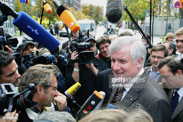 Leader of the Bavarian Christian Democrats Horst Seehofer gives a statement to journalists after the second round of coalition negotiations between...