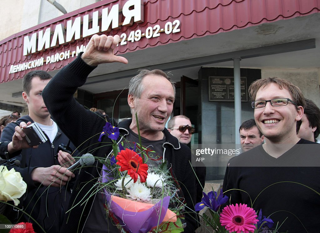 Leader of the Belarussian opposition 'Say the Truth' campaign, poet Vladimir Nekliyaev (C) and activist Anatoly Dmitrev (R) speak to the press in Minsk on May 21, 2010 after being released from 3 days in jail. Nekliyaev and several other opposition activists were arrested after raids of the 'Say the Truth' headquarters on May 18.