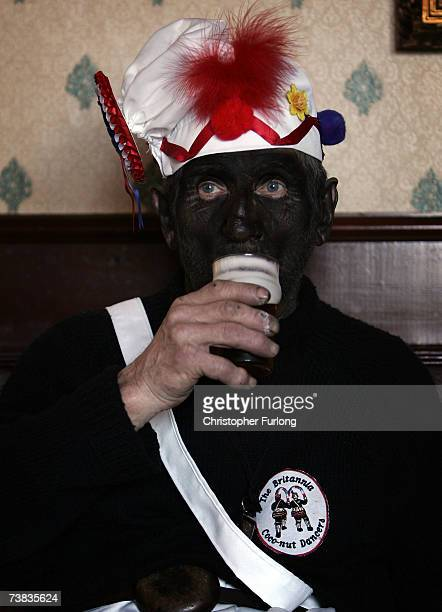 Leader of the black faced Morrismen of the Britannia Coconutters Dick Shufflebottom aged 73 drinks beer as he takes part in his 50th Easter ritual as...