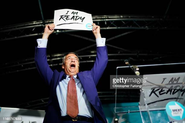 Leader of the Brexit Party Nigel Farage addresses party members and delegates at the JobServe Community Stadium during the first rally of the Brexit...