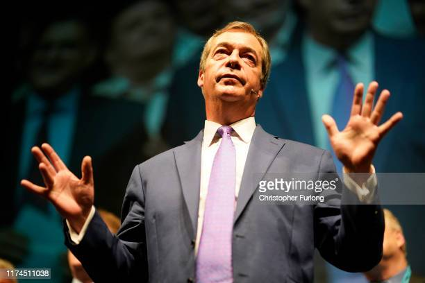 Leader of the Brexit Party Nigel Farage addresses party members and delegates at the Southport Theatre Convention Centre during the Brexit Party...