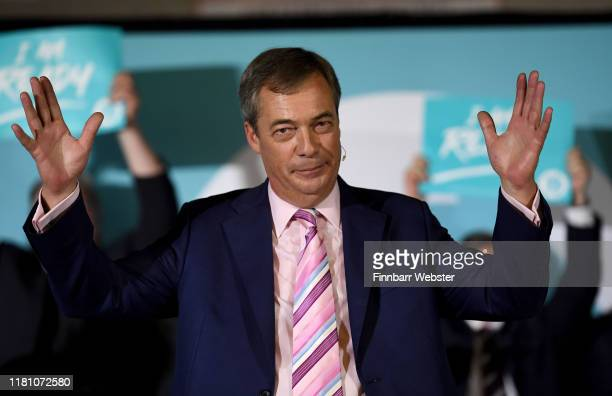 Leader of the Brexit Party Nigel Farage addresses the audience at The Brexit Party rally at Carn Brea Leisure Centre on October 14 2019 in Camborne...