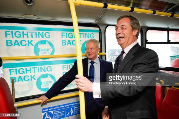 Leader of the Brexit Party Nigel Farage and the party's Peterborough constituency byelection candidate Mike Greene travel on a campaign bus on May 09...