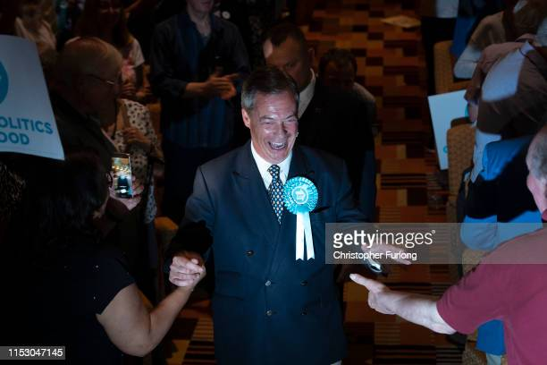 Leader of the Brexit Party Nigel Farage arrives to attend a rally at The Broadway Theatre on June 01 2019 in Peterborough England Mike Greene is the...