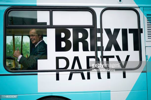 Leader of the Brexit Party Nigel Farage give a thumbs up to the media on a campaign bus after announcing the party's Peterborough constituency...