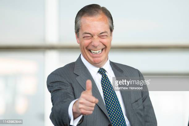 Leader of the Brexit Party Nigel Farage gives a thumbs up sign at the Senedd in Cardiff Bay on May 15, 2019 in Cardiff, Wales. Nigel Farage, leader...