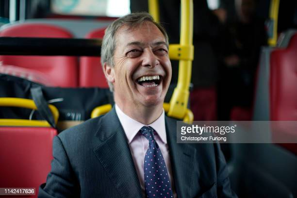 Leader of the Brexit Party Nigel Farage on the campaign bus with the party's Peterborough constituency byelection candidate Mike Greene on May 09...