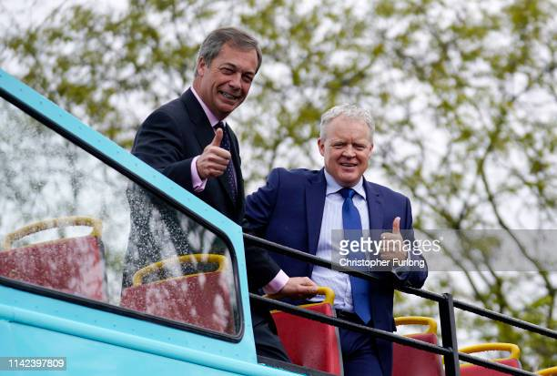 Leader of the Brexit Party Nigel Farage poses for the media on a campaign bus with the party's Peterborough constituency byelection candidate Mike...
