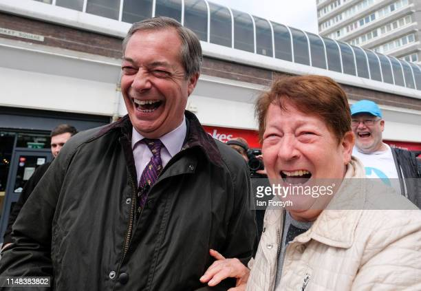 Leader of the Brexit Party Nigel Farage talks with members of the public as he walks through Sunderland Market Place during a Brexit Party campaign...