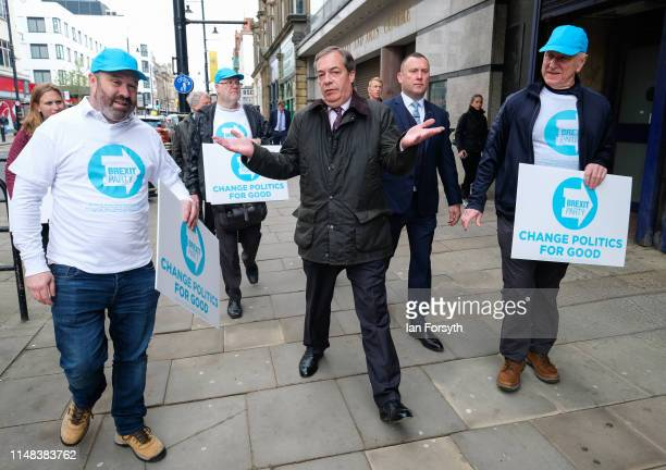 Leader of the Brexit Party Nigel Farage walks through Sunderland Market Place during a Brexit Party campaign visit on May 11 2019 in Sunderland...