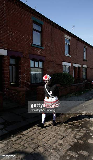 Leader of the Britannia Coconutters Dick Shufflebottom aged 73 pounds his clogs on the cobblestones as he takes part in his 50th Easter ritual and...