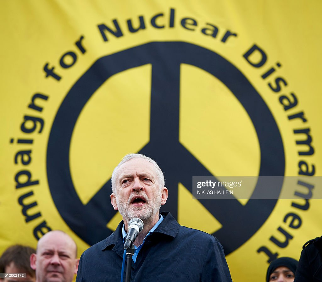 Leader of the British opposition Labour Party, Jeremy Corbyn (C), gives a speech during a rally against a proposed renewal of Britain's Trident nuclear weapon system in Trafalgar Square central London on February 27, 2016 Tens of thousands of people joined a protest in central London Saturday against the renewal of Britain's nuclear weapon system Trident. A decision is expected to be taken later this year on replacing the ageing submarines which carry the Trident missiles at an estimated cost of 31 billion GBP (39 billion euros, 43 billion USD). / AFP / NIKLAS HALLE'N