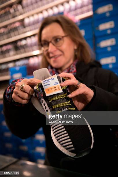 Leader of the BVG Berlins´s public transport network Sigrid Nikutta poses with a pair of sneakers with a public transport ticket as people queued up...
