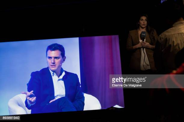 Leader of the center right party Ciudadanos Albert Rivera seen on screen speaking at a meeting in a theater ahead of the forthcoming Catalan...